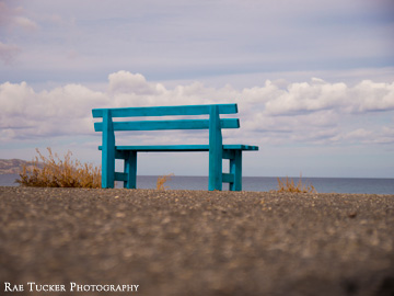 A blue bench overlooks the Aegean Sea in Kissamos, Crete