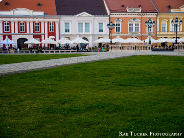 Buildings and patios lining Unity Square in Timisoara, Romania