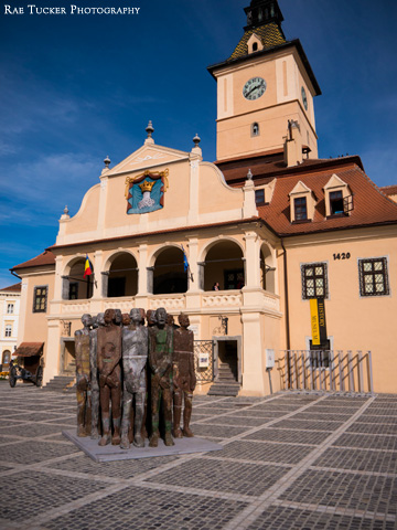 Statues displayed in front of Brasov Town Hall in Transylvania, Romania