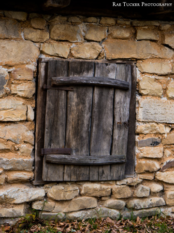 An old wooden shutter on a stone shed found in the Village Museum in Bucharest, Romania.