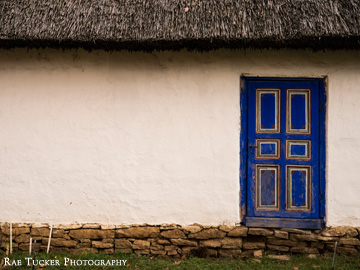 A blue painted door stands out on this house found in the Village Museum in Bucharest, Romania