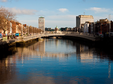 The Ha'penny Bridge stretches over the River Liffey in Dublin, Ireland