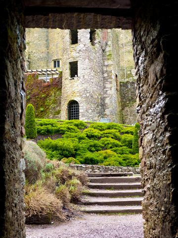 A stone doorway leads to the Blarney Castle in Ireland.