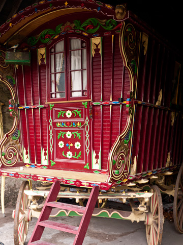 An ornately painted wooden wagon in ireland.