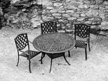 A table and chairs inside a stone castle in Ireland.