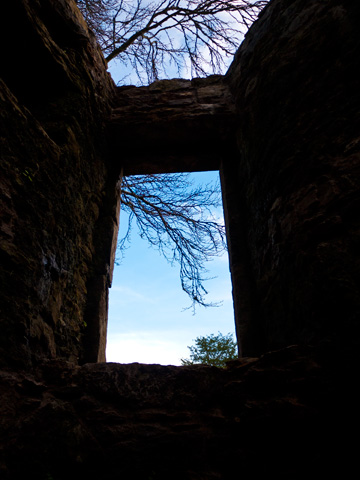 A winter sky viewed through a stone tower of the Blarney Castle.