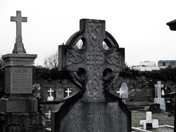 Celtic Cross headstones in a graveyard in Galway, Ireland.