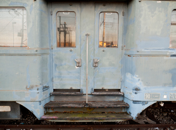 Sunset reflections in the windows of an old train car in Emilia Romagna, Italy