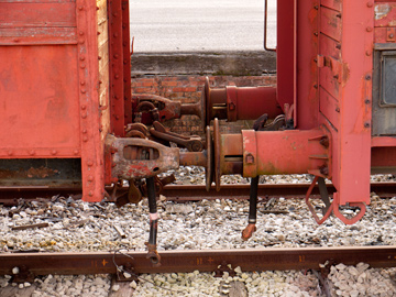Two rusted train cars coupled.