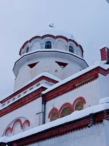 A snow capped red and white church in Sofia, Bulgaria
