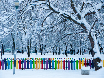 A colorful playground fence stands out amongst the snow in Sofia, Bulgaria