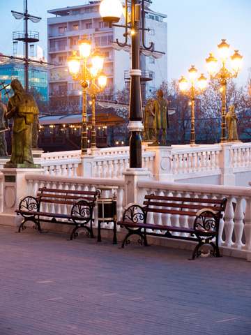 Benches offering a spot to rest by the Art Bridge in Skopje, Macedonia