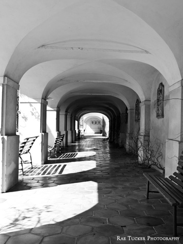 Light and shadows in a black and white image of a covered walkway in the South Bohemia region of Czechia