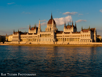 The late afternoon sun sparkles off of the Hungarian Parliament building and Danube River in Budapest.