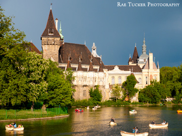 Rowers enjoy the late afternoon sun on the pond in City Park in Budapest, Hungary