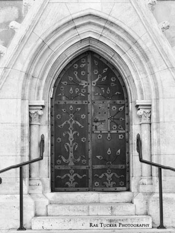 A black and white image of an ornate door on Matthias Church in Budapest, Hungary