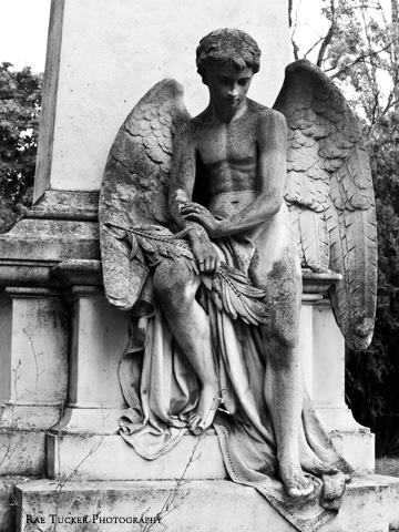 A stone angel in mourning at a cemetery in Budapest, Hungary