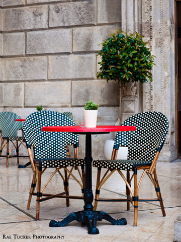 Bistro tables and chairs on a patio in Budapest, Hungary
