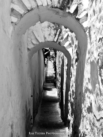 A black and white image of a narrow walkway in Szentendre, Hungary