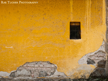 A worn yellow wall in Szentendre, Hungary