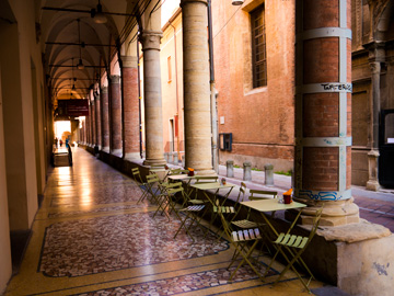 A small patio under a portico in Bologna, Italy