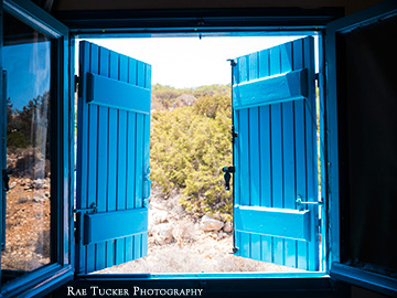 Looking outside through blue shutters