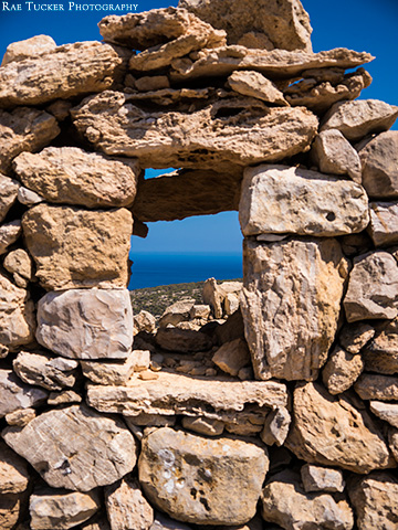 A rock wall provides a window overlooking the Libyan Sea on the island of Gavdos in Greece.