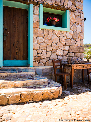 A stone building with a wooden table in Greece