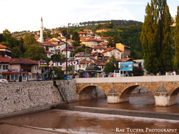 The riverbank in the glow of the setting sun in Sarajevo, Bosnia
