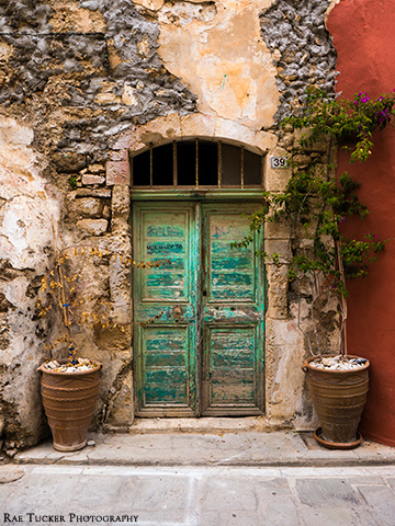 An old, turquoise door in Rethymno on the island of Crete in Greece
