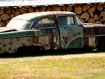 An old, rusted car