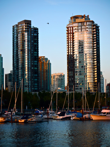 Condo buildings and sailboats along Vancouver's False Creek