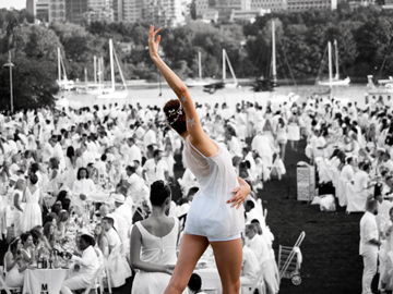 A dancer performs before a large crowd in Vancouver, Canada