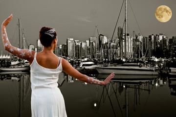 A ballerina dancing under the super moon in front of the Vancouver skyline and harbour