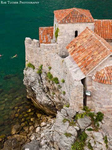 Red-tiled roofs top the stone buildings in Budva's old town in Montenegro.