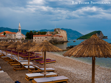 Storm clouds gather over the old town and beaches of Budva, Montenegro