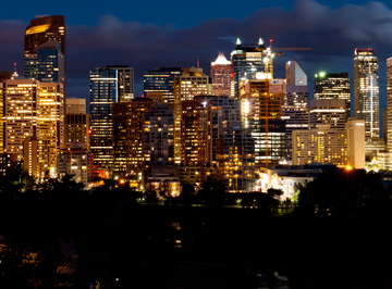 The skyline of downtown Calgary, Alberta illuminated at night.