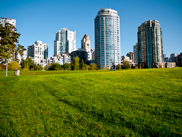A man cycles through a park in Yaletown in Vancouver, British Columbia