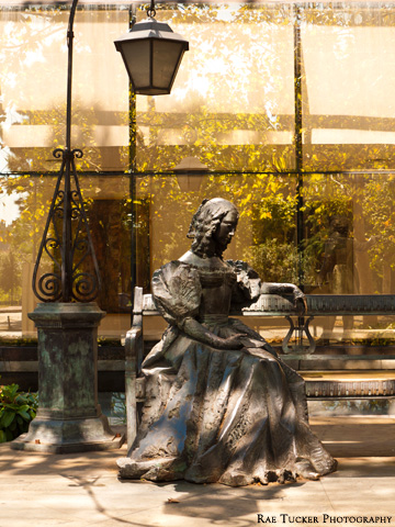A statue of a woman on a bench in Podgorica, Montenegro