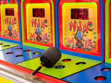 A Whac-A-Mole game at a carnival