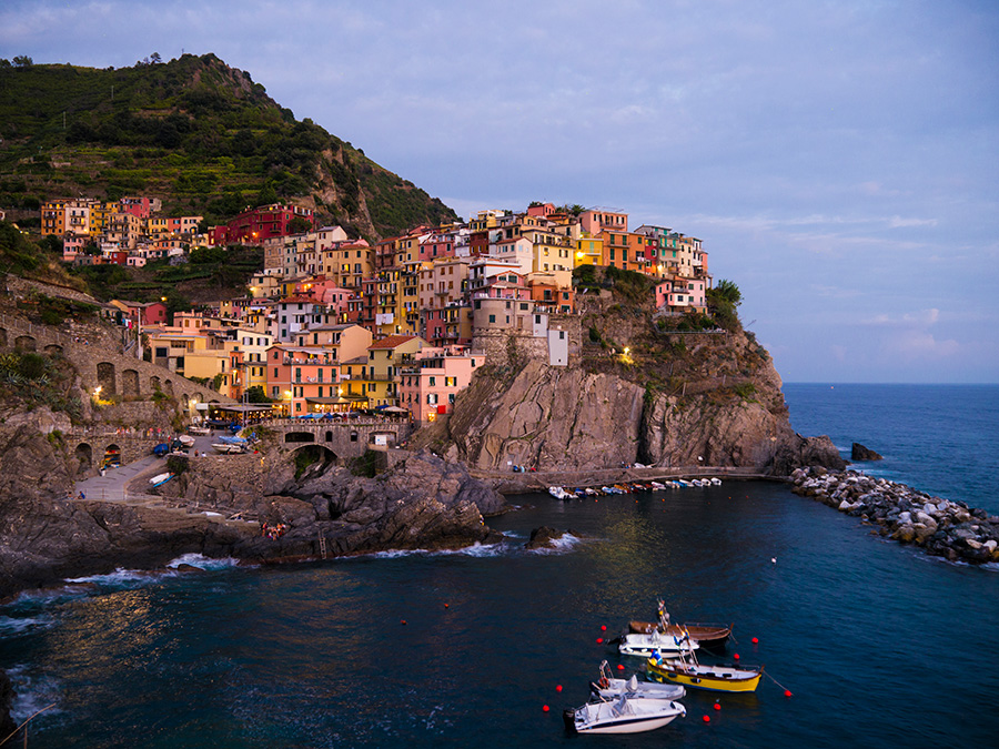 Dusk settles over the town of Manarola in the Cinque Terre in Italy.