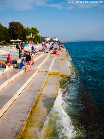 Waves crash against the Sea Organ in Zadar, Croatia