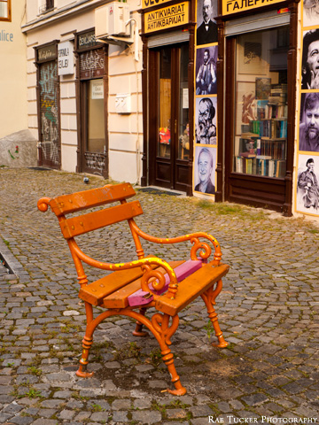 An orange bench in front of a book store in Ljubljana, Slovenia