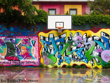 Colorful street art on a basketball court in Metelkova Mesto