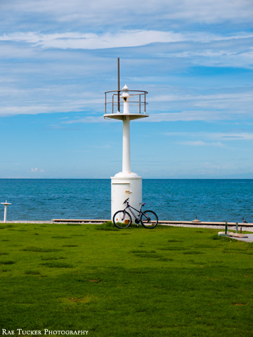 A lighthouse and bicycle in Izola, Slovenia