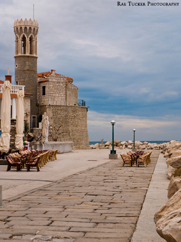 Patios, the church and lighthouse in Piran, Slovenia