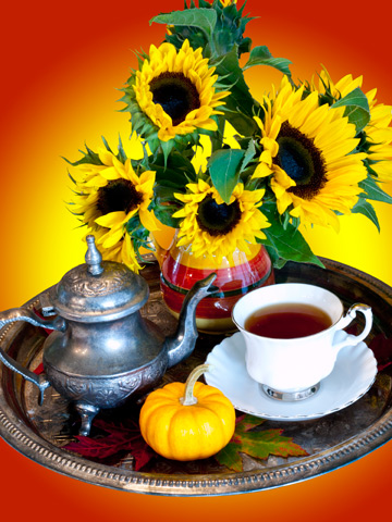 Autumn Tea Service - a silver tray decorated with an antique teapot, china teacup, pumpkin, sunflowers and leaves.