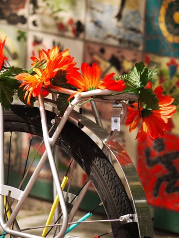 A bicycle is decorated with flowers outside of the Roundhouse Community Centre in Vancouver, British Columbia
