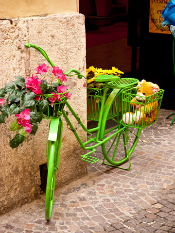 Green bicycle in Verona, Italy