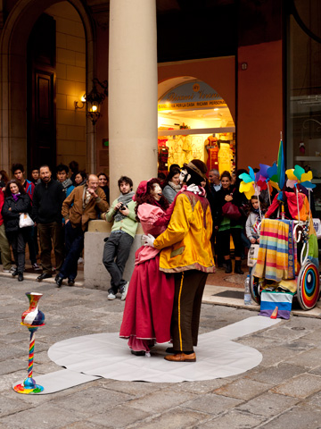Dancing puppet street performance in Bologna, Italy